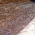 Stamped concrete pool deck addition in College Park (Orlando) in Flagstone pattern.